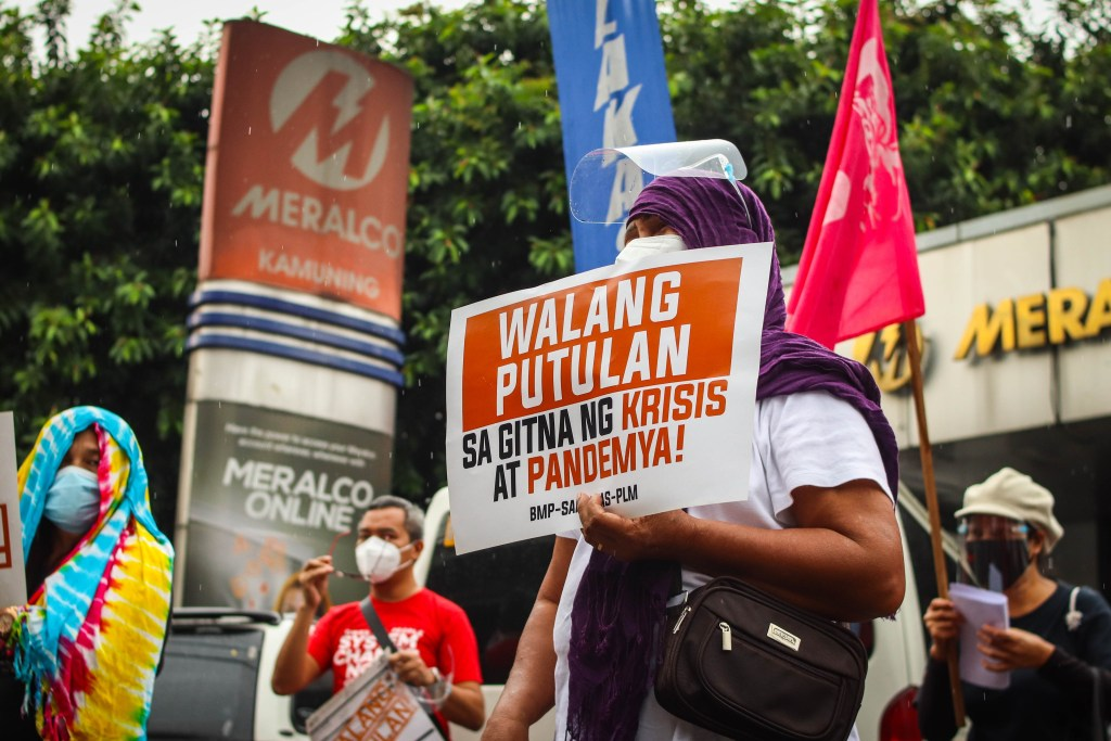 Consumers troop to Meralco offices to demand no disconnections due to 'bill shock'